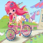 Kerékpáros kislány öltöztetős játék